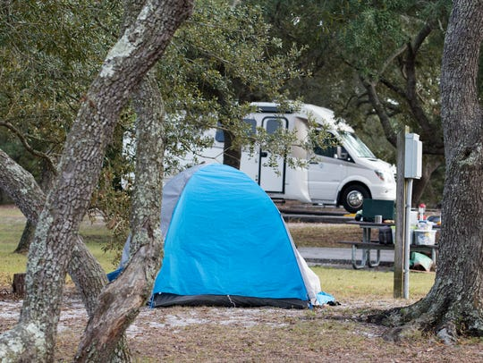 Tents and RV's set up next to each other at the Fort Pickens campgrounds in Pensacola on Monday, December 4, 2017.