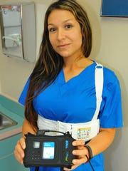 Courtney Gutierrez from Dr. Bean's office models a LifeVest.