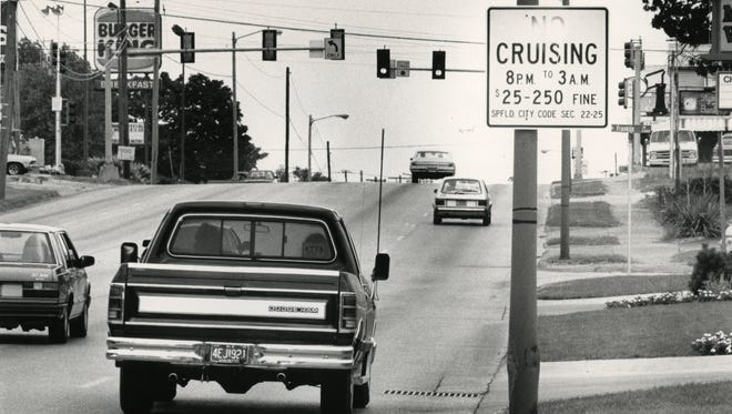 "Vandals spray painted over a ""No Cruising"" sign on Kearney Street in July of 1991."