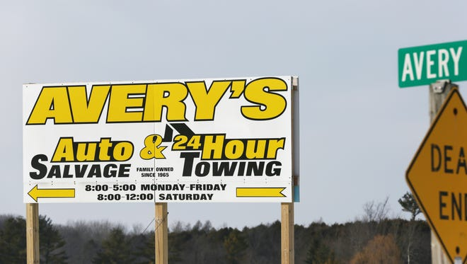The Avery's Auto Salvage sign stands at the intersection of West Main Street and Avery Road in Manitowoc County.