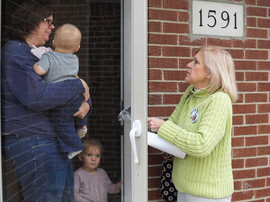 Republican volunteer Barbara Barber, right, talks to Madison Heights resident Annette Whitaker on Thursday while knocking on doors to garner support for Gov. Rick Snyder and U.S. Senate candidate Terri Lynn Land.
