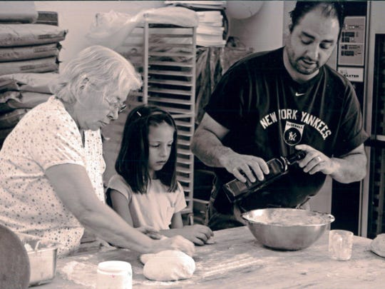 George Formaro cooks with his mother Gina and daughter Bella.