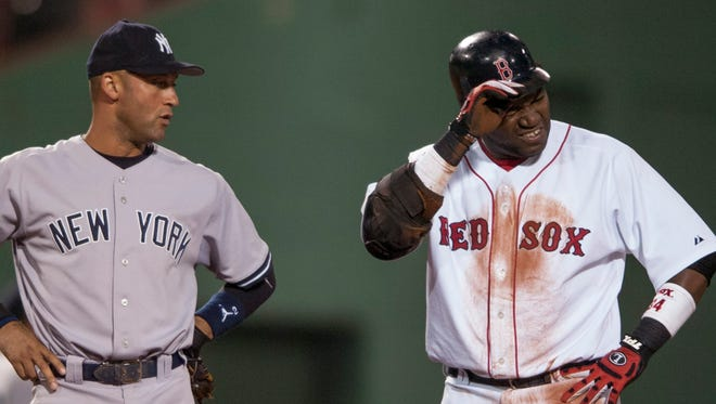 epa05561222 In a photograph made available 28 September 2016,  David Ortiz (R) of the Boston Red Sox reacts to dirt in his eye as former New York Yankee Derek Jeter looks on during the game at Fenway Park in Boston Massachusetts USA 20 August 2006. The Boston Red Sox future hall of famer is due to retire at the conclusion of the 2016 season after 20 seasons in the Major Leagues. Ortiz, who joined the Boston Red Sox in 2003, was a member of three World Series Championship teams with the Sox in 2004, 2007 and 2013. Nicknamed 'Big Papi,' the Dominican-born designated hitter, who occasionally plays first base, has also been on ten All-Star Teams in his career and will be celebrated by the Boston Red Sox at Fenway Park in Boston on 02 October 2016, the last game of the regular season.  EPA/CJ GUNTHER ORG XMIT: CJX11
