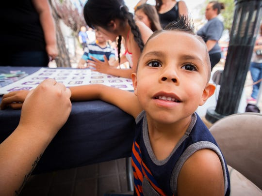 4-year-old Adrian Montoya gets a temporary Ninja Turtle tattoo at Kid's Night Out on Main St., June 11, 2016.