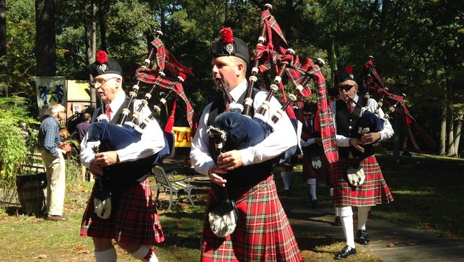 Pipe major Pat Harmon, left, and Matt Wallace play the bagpipes at this weekend's Celtic Festival in Snow Hill.