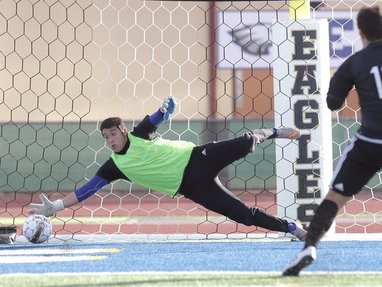 San Elizario goalkeeper Luis Castro just misses a penalty