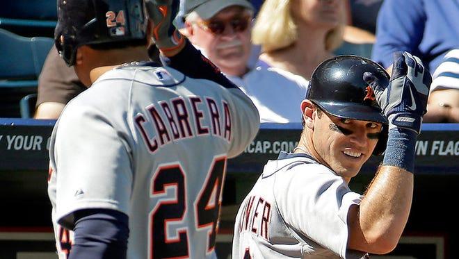 Tigers first baseman Miguel Cabrera celebrates second baseman Ian Kinsler's home run during Sunday's loss in Kansas City, Mo.