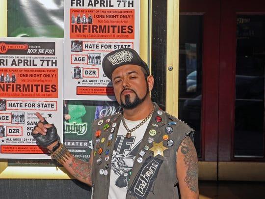 Jason Martinez at the playbill of the Fox Theater,