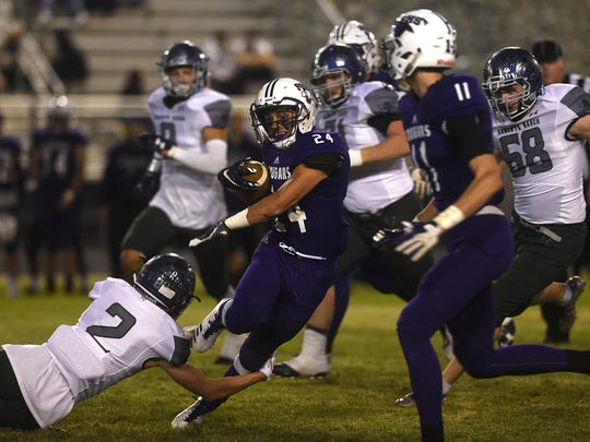 Spanish Springs' Gabby Ordaz (24) tries to break a tackle while taking on Damonte Ranch during their football game at Spanish Springs on Sept. 15,