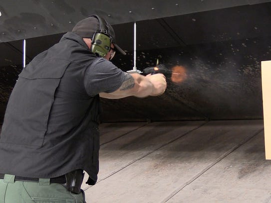 A federal air marshal trains at a TSA firing range in Egg Harbor Township, N.J. Air marshal instructors say the service has the highest average scores in marksmanship among federal law enforcement.