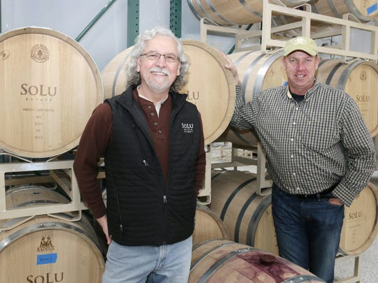 Winemaker Frederick Niffenegger, left, and TJ Sommer, proprietor of SoLu Estate, pose by barrels used in wine making Tuesday April 12, 2016 near Cascade.