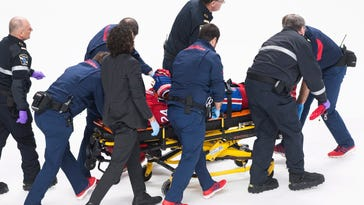 Canadiens C Danault leaves with head injury after scary play