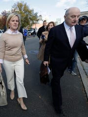 Bridget Anne Kelly, left, former Deputy Chief of Staff for New Jersey Gov. Chris Christie, walks with her lawyer Michael Critchley after she was found guilty on all counts in the George Washington Bridge traffic trial at Martin Luther King, Jr., Federal Court, Friday, Nov. 4, 2016, in Newark, N.J. (AP Photo/Julio Cortez)