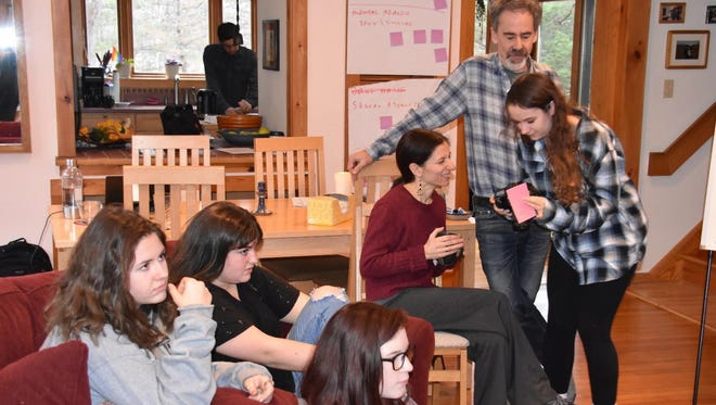Maya Gold Foundation Teen Advisors Lianna Maley, left to right, Hannah Goichman, Amelia Verderosa and Ana Alexander work with board members Noelle Adamo and Paul Alexander on developing the 2017 Community Series.