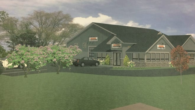 A Mazur Automotive repair shop is proposed for the site of the old Dewey's Tavern, a vacant and dilapidated eyesore on the corner of M-36 and Chilson Road in Hamburg Township.