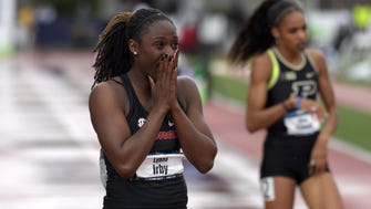 Lynna Irby reacts after winning the women's 400m in a meet record 49.80 during the NCAA Track and Field championships at Hayward Field in Eugene, Ore.