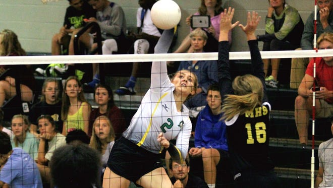 Catholic's Ellen Floyd hits a kill shot in this file photo.
