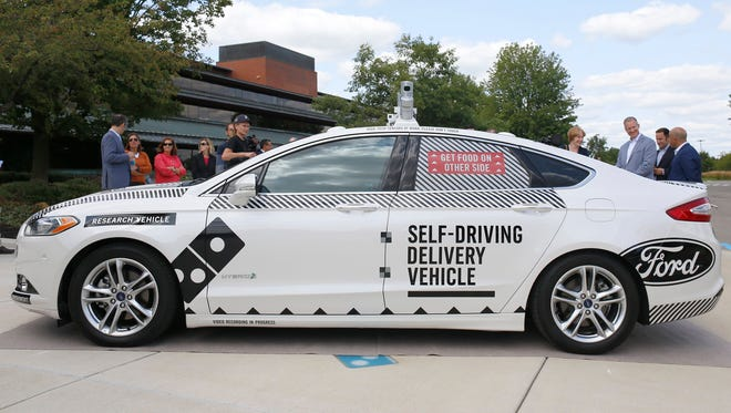 The Ford Fusion hybrid autonomous research vehicle, which will be used as the self-driving pizza delivery vehicle in a partnership between Ford and Domino's, photographed on Friday, August 25, 2017 at Domino's Farms in Ann Arbor.