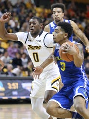 Delaware's Anthony Mosley (3) drives against Towson's