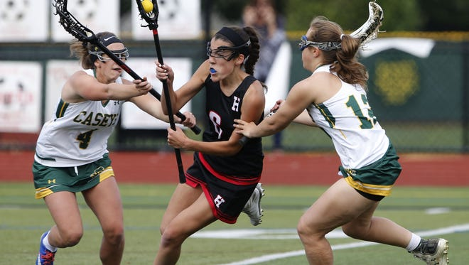 Erika Recanzone (4) and  Alexa Benzene (12) od Red Bank Catholic defend against Gabi Connor (6) of Haddonfield  during girls lacrosse game at Count Basie Field. Red Bank,NJ. Monday, May 23, 2016. Noah K. Murray-Correspondent/Asbury Park Press ASB 0524 RBC Girls Lacrosse