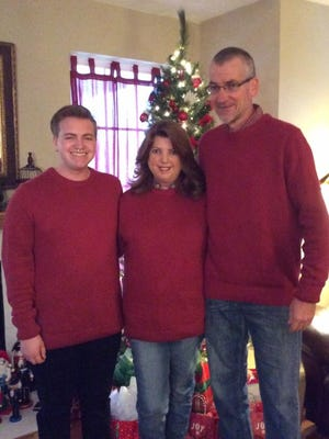 This is the Holm family at Christmas in 2015: Jeydon, 18, Jennifer and Dan. Jennifer Holm said the photo shows where glands on the sides of her jaw and near her ears are swollen and one side of her neck is swollen because of the glands. She believes sarcoidosis has invaded those glands.