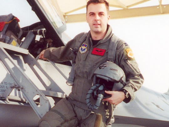 Major Troy Gilbert stands on the ladder of an F-16 at Luke Air Force Base, Ariz. Gilbert, an F-16 Fighting Falcon pilot, was killed Nov. 27, 2006, in an F-16 crash 30 miles southwest of Balad Air Base, Iraq. Gilbert was the standardization and evaluation chief for the 332nd Expeditionary Operations Group and was deployed from the 309th Fighter Squadron from Luke Air Force Base, Ariz.