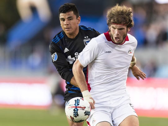 Tommy Heinemann (right) chases down a ball against the San Jose Earthquakes.