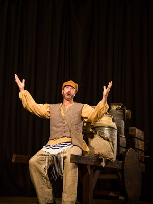 "Joel Barber performs as Tevye during a rehearsal for the production, ""Fiddler on the Roof."""