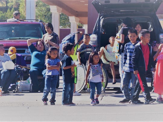 Many children with bags ready for the candy thrown at the AspenFest parade Saturday in Ruidoso.