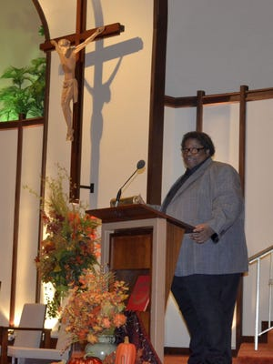 The Rev. L.C. Green from Divine Temple Church of God in Christ gives the sermon at the annual interfaith Thanksgiving worship service at St. Mary of the Angels Parish in Green Bay on Nov. 24, 2015. A Martin Luther King Jr. Day service will be held at Divine Temple in downtown Green Bay at 11 a.m. Monday.