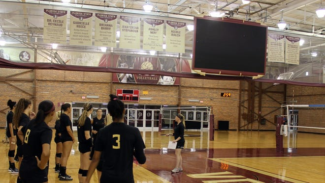 FSU's volleyball team took to its first practice of the season at Tully Gym with freshly-polished floors and a new videoboard overhead.