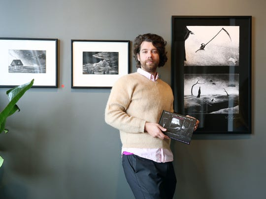 "Nicholas Gurewitch poses with artwork from ""Notes on a Case of Melancholia, Or: A Little Death,"" at Makers Gallery and Studio, where he had a show in January 2018."