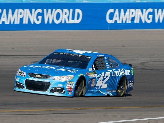 Kyle Larson drives out of Turn 4 during the NASCAR Cup Series auto race at Phoenix International Raceway, Sunday, March. 19, 2017, in Avondale, Ariz. Larson finished second in the race. (AP Photo/Ralph Freso)