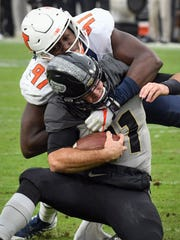 Purdue quarterback David Blough is knocked out of the