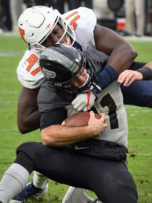 Purdue quarterback David Blough is knocked out of the game on a hit by Illinois' Bobby Roundtree in Purdue's 29-10 win in West Lafayette on Saturday, November 4, 2017.