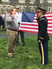 2nd Lt. Ben Crabtree, right, chose his grandfather Master Sgt. Don Welsh, U.S. Army retired, to render his first salute after being commissioned.