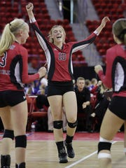 Newman Catholic's Mariah Whalen (10) celebrates after