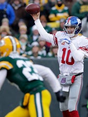 Giants quarterback Eli Manning throws in the first quarter as the Packers host the Giants in an NFC wild card game on Jan. 8, 2017, at Lambeau Field.
