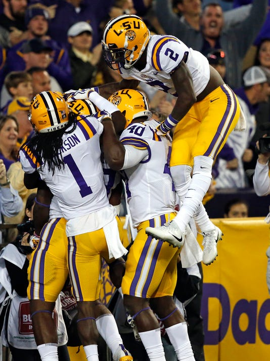 LSU players celebrate an interception during the first half of an NCAA college football game against Texas A&M in Baton Rouge, La., Saturday, Nov. 25, 2017. (AP Photo/Gerald Herbert)
