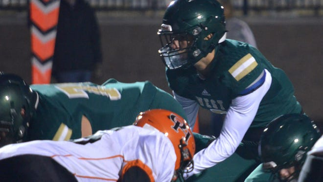 Zeeland West quarterback Carson Gulker gets ready to take a snap on Friday.