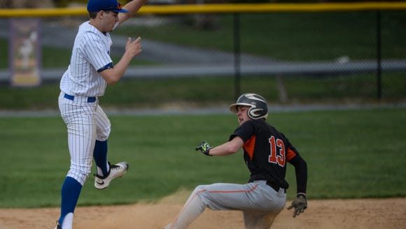 Palmyra's Dylan Spagnolo slides into third base for
