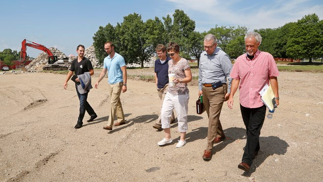 Steve Viars, right, senior pastor at Faith Church, is joined by Stephen Toyra, from left, Josh Greiner, Adam Murphy, Lori Walters and Arvid Olson, all involved with the development, as they tour the site for a new community center Thursday, July 6, 2017, between the former New Community School and Market Square in Lafayette. Viars said the $14.5 million facility will open in the summer of 2018. Viars said the community center will reflect the ethnic diversity of Lafayette's north end.