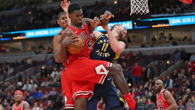Chicago Bulls forward Bobby Portis (5) and Indiana Pacers center Domantas Sabonis (11) fight for a rebound during the second half at the United Center.