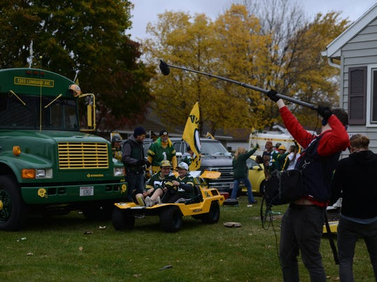 "Extras act out a tailgate party during filming of ""The 60 Yard Line"" at a house on the corner of Oneida Street and Stadium Drive Green Bay."
