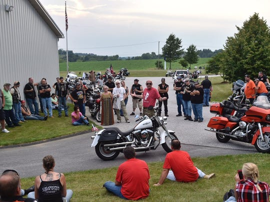 Ryan Walton, who organized the biker parade in support of Corney, speaks to supporters at Freedom Armory.