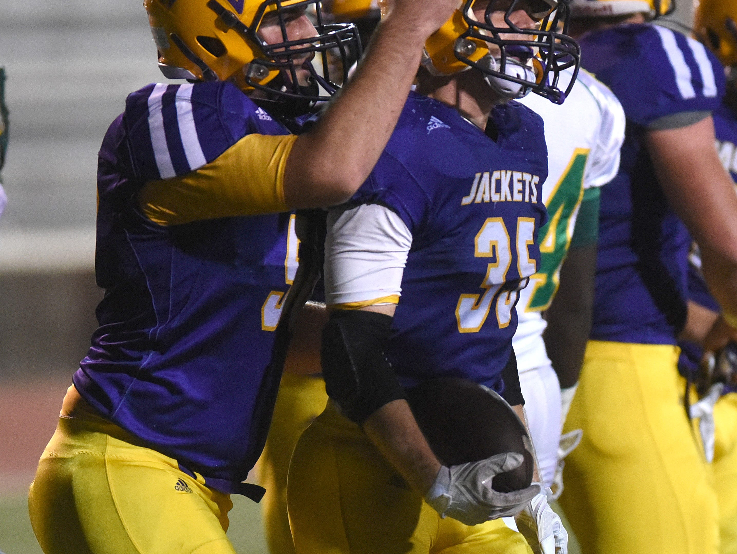 C.E. Byrd's Bailey Obyrne is congratulated after scoring his second touchdown against Green Oaks.