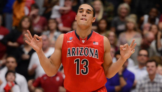 Arizona Wildcats guard Nick Johnson celebrates after making a three-point basket against the Stanford Cardinal during the second half at Maples Pavilion.