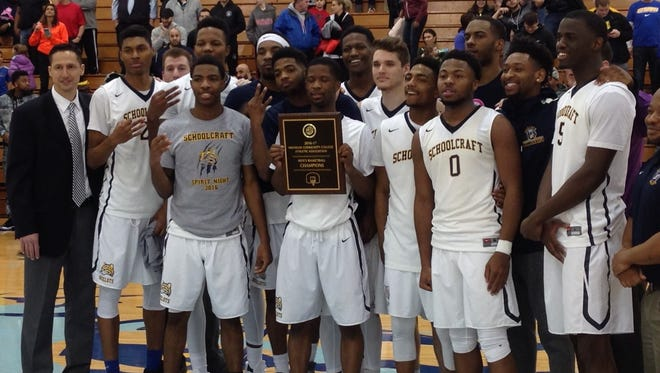 Schoolcraft College's men's basketball team rallied Saturday to win the MCCAA championship. It was the third straight title for the Ocelots, coached by Abe Mashhour (far left).