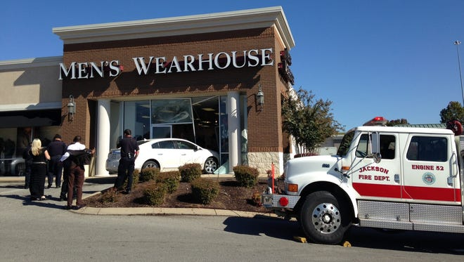 A car ran into the front of the Men's Wearhouse store on Vann Drive this afternoon.