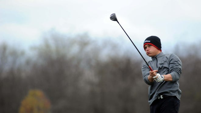 Coshocton's Gage Bosson stares down his tee shot on the 18th hole during the final round of the Division II state tournament at North Star Resort on Saturday.
